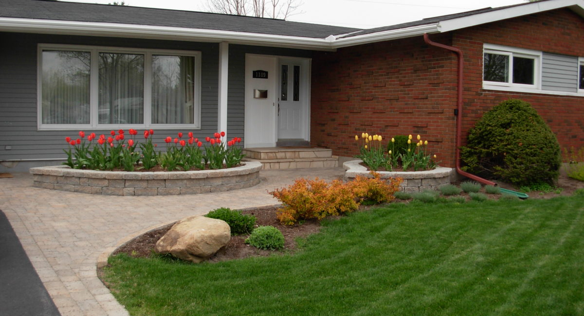 lawn, raised planter boxes, natural stone, shrubs
