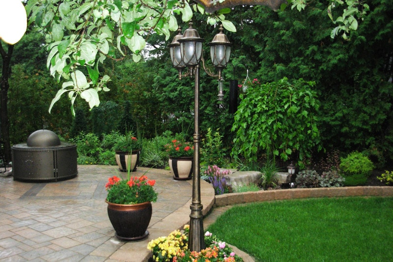 beautiful lamppost lighting plants greenery