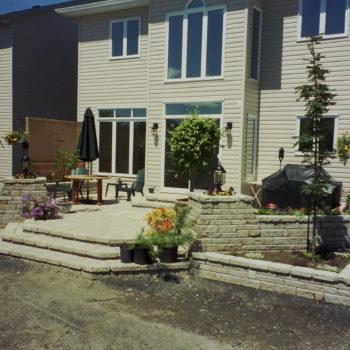 raised patio, stones, steps, shrubs, pergola